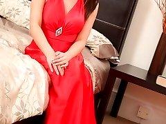 Siobhan posing in silk dress and pantyhose