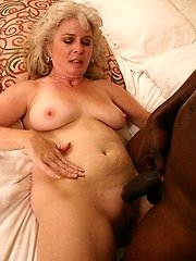 Horny momma enjoying huge black cock