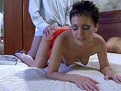 Seductive milf in a red spandex dress gives head and gets pounded from behind