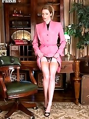 Holly provides suitable entertainment in her vintage bullet bra, matching garter belt and fancy heel nylons...