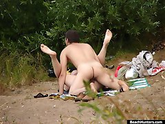 Pashful fuckster rubbing up a chickie on a river shore