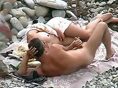 Beach blonde fondles the erection of her BF