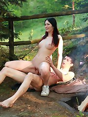 The sun is starting to go down on the forest outside of Dorf, but this teen`s cock is starting to go up as he fools around with this barely legal nympho near the campfire.