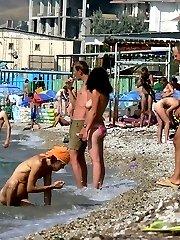 Watch her bathe her amazing teen body in the water