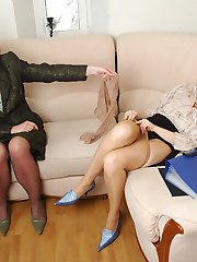 Freaky secretary babes admiring luxury hosiery during lick-n-kiss action