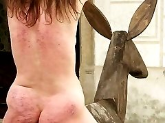Brutally caned in the dungeon - blistered ass and exposed cunt in diaper position