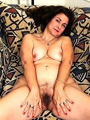 Mature Latina Gianna Jones spreads her hairy pussy.
