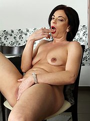 Exotic mature babe Zoe Gyro fingers her twat.