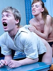 Bossy gal enjoys dominating her male co-worker using a huge strapon cock
