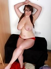 Hot geek Georgina Gee loves stripping and playing with her natural big tits