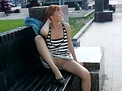 Sweet coed in striped dress sits on hunkers and shows cunt