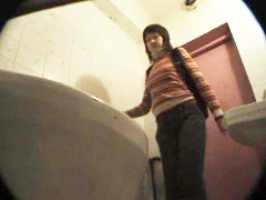 3 ladies watering the spy cam planted in univercity loo