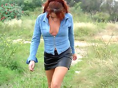 Redhead bitch taking a hike to scratch her pussy itch!