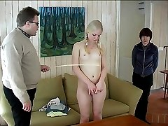 Hot blonde girl is exposed fully nude for a severe caning