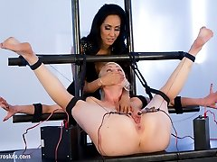 Lorelei Lee gives up control to beautiful and cruel Isis Love in this rare Electrosluts battle of the stars.  Lorelei is bent half, her toes and fingers tied to electroclamps attached to her labia and nipples.  In this restrictive predicament bondage position, her every move is agony and she must give in, allowing herself to be totally helpless and meet her mistress's every whim. Isis toys with her, teasing her exposed clit and ass before bringing in the anal speculum to stretch that hole nice and wide - a pleasure made more exciting when the electricity is turned up and Lorelei begins to scream and squirm, tugging on her electroclamps and begging for more.