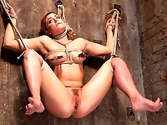 Dahlia is back and this time she will endure some of the most brutal bondage she's ever faced. Every position is designed to push her body's to total destruction. First she is standing with one leg up and totally helpless. Her clothes are slowly ripped away as she is molested by her captor. Now that she's understands his plot of destruction, Dahlia is suspended on a wall with her legs spread wide. The torment worsens, but there's nothing this helpless slut can do to stop it. Her pussy is used up as we see her orgasm uncontrollably. Next we have her bent over and being pulled in every direction to keep her from moving at all. Dahlia is flogged, spanked, caned, subjected to severe bastinado, and fucked until she is on the verge of breaking.In the final scene we prove why Hogtied.com is the best bondage site in the world with one of the most grueling suspensions anyone could possibly endure. She is hanging from a single point around her waist with one foot tightly tied to the other leg, and that leg is tied to her wrist that hold her in a brutal strappado.