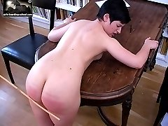 Teen caned hard on her big round ass