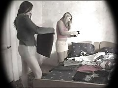 Two sexy college hoes get changed right in front of a spy camera in their room