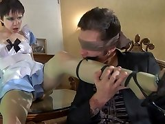 Uniformed maid blinds her master with tan pantyhose for some nylon make-out