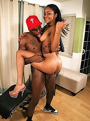 Long haired ebony teen cutie takes a black cock load in her mouth