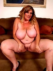 Sexy photos of blonde BBW Deedra stripping off her clothes and acting sexy for the camera
