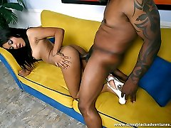 Black hottie rides a big swollen black dong in a couch