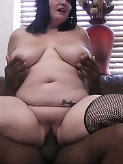 Tattooed brunette plumper got her holes plundered with large black cock at work