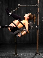 Welcome back and congratulate AVN award winner Remy LaCroix for this year's Best Starlet and Best Tease awards! Remy has an amazing body and great attitude. The ultimate girl next door gets a smack down today on Device when she learns how unforgiving our bondage predicaments can truly be. First, Remy is bound standing with her arms above and ankles locked together in a stretched out bow pose. At first she has no arch, but as the scene progresses her bondage gets more and more restrictive. What Remy fails to mention is that she has a deep fear of the single tail. You can see her terror in the way she moves, desperate to avoid the pain. She is worked over. Almost immediately her eyes welt with moisture. To reward her efforts, Claire adds a suction tube to Remy's clit. She mentions in the interview she cums easily... after it has time to draw all the blood and sensitivity to the area, the tube is removed and the vibrator introduced. Remy cums fast, hard, and intense... just the way we like it.Second is a very short but very intense scene. Not every body is designed to take every position, and the hairpin is one that is exceptionally hard for Remy, but we want to see her suffering and her eroticize the pain. Remy is bound laying on a reclining board with metal shackles on her forearms and wrists, and leather binding her to the board and her ankles above. Time is limited and we go for gold. Immediately a dick with a vibrator is in her cunt. Her eyes roll back with pleasure. Then another in her ass... at the same time. Orgasm after orgasm keeps cumming in her intense and uncomfortable bondage double penetration ordeal until she can't take it anymore. Finally Remy is bound in a face down and spread leather strap suspension. She is paddled, flogged, nipples suctioned and hand delivered a staggering amount of orgasms. Again the bondage is extremely challenging for her, but she perservered and ultimately rewarded with pleasure.