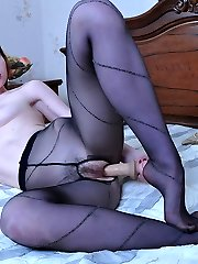 Footsie chick stuffs a rubber cock and licks her tastey toes thru pantyhose