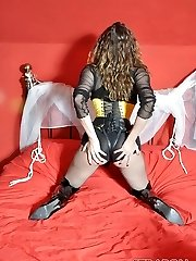 Female Domination Strap On Dildo Jane plays with her huge strap-on cock dressed in fishnets, boots and yellow corset