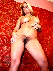 Busty blondie Joclyn Stone does a nasty striptease and makes her hairy pussy wet in her solo show
