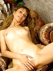 Skinny brunette slut nakedly displays her tufted twat wanting to be fucked.