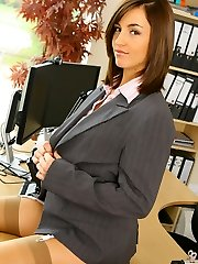 Melanies brilliant figure is flattered by the sexy undergarments under her suit skirt and blouse