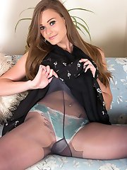 Enjoy some time with a very horny Honour as she strips off to skimpy panties and grey nylon pantyhose!