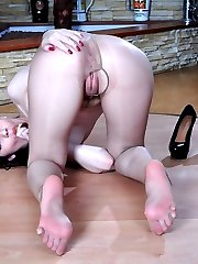 Anal-loving girl in barely there pantyhose and stiletto heels plays footsie