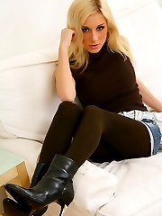 Stunning Tindra undresses from her short denim skirt, and tight brown top