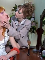 Cute sissy in a fiery wig getting made up and ass fucked by a strapon lady