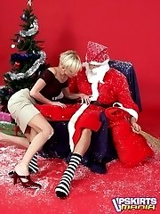 Short haired blondie in skirt gets undressed by Santa and mouth drilled