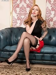 Alexa flaunts her black sheer nyloned legs and neat trimmed ginger pussy, in as an arousing display of self pleasuring!