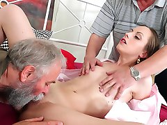 This babe is young and hot and in this scene you will watch her fuck two men who are at least three times her age. Does that turn you on? Then sit back and relax and get ready for a mind blowing old and young porn scene…