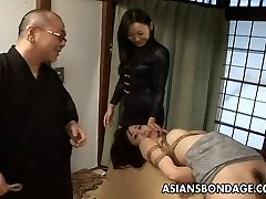 Tied up Chinese babe gets spanked and dildo plumbed