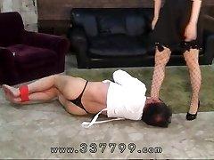 Japanese femdom slaves schlong in sexy wax.