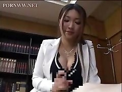 Asian secretary gives one of her coworkers a precious afternoon tugjob