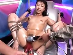 Tied Asian slut gets stimulated by toys to ejaculation