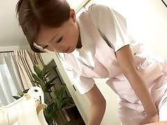 Sexy Nurse jacks her patient's cock as a approach