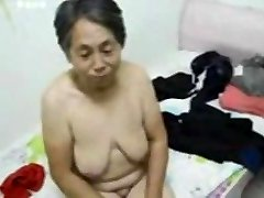 Asian Granny get dressed after hookup