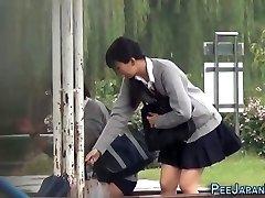 Asian teen urinate park