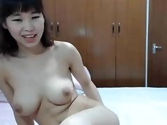 chinese good-sized tit finger her bum