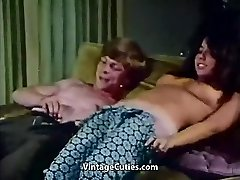 Young Couple Pokes at Palace Party (1970s Vintage)