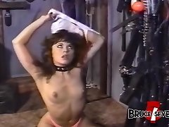 Lesbian femdom playing with her restricted submissive